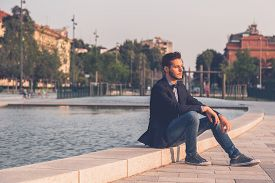 foto of bow tie hair  - Young handsome man with short hair wearing a bow tie and posing in the city streets - JPG