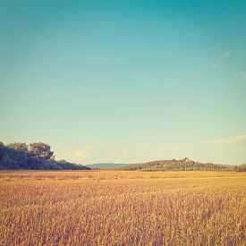 foto of farmhouse  - Farmhouse on the Hill in the Middle of the Field After Harvest Instagram Effect - JPG