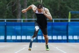 pic of handicapped  - Explosive start of athlete with handicap at the stadium - JPG
