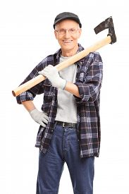 picture of shoulder-blade  - Vertical shot of a senior man holding an axe over his shoulder and looking at the camera isolated on white background - JPG