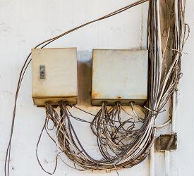 foto of breaker  - Breaker box on old dirty wall on background - JPG