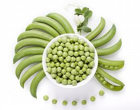 stock photo of pea  - Fresh green peas in a white bowl pea pods are round bowls and a pea on a white background - JPG