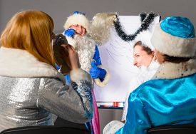 stock photo of conduction  - santa claus is conducting a business training - JPG