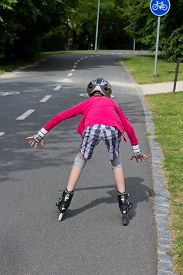 stock photo of dangerous situation  - Girl roller skating and is close to a fall  - JPG