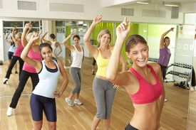 picture of fifties  - Women Taking Part In Zumba Class In Gym - JPG