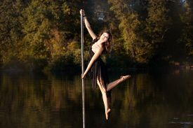 stock photo of lap dancing  - Girl dancing around a pole - JPG