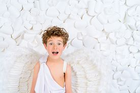 stock photo of cupid  - Portrait of a lovely little boy in a costume of angel - JPG