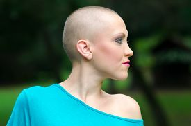 stock photo of chemotherapy  - Happy young cancer survivor after successful chemotherapy enjoying day in the nature - JPG