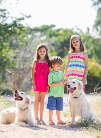 picture of three sisters  - Three children with two dogs - JPG