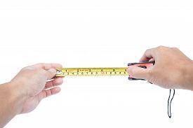 stock photo of nylons  - Hand holding nylon measurement tape - JPG