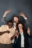 stock photo of bifocals  - Two male and one female nerd celebrate and dance - JPG
