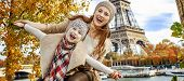 Smiling Mother And Daughter Travellers Having Fun Time In Paris poster