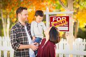 Young Mixed Race Chinese and Caucasian Family In Front of Sold For Sale Real Estate Sign and Fall Ya poster