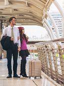 Couple Travellers Walking In Airport Walkway poster