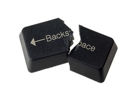 stock photo of backspace  - Backspace button cut in half depicting no undo isolated on white background - JPG
