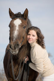 image of horse-riders  - portrait of girl and horse - JPG