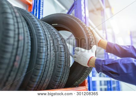 poster of Tires In A Tire Store, Spare Tire Car, Seasonal Tire Change, Car Maintenance And Service Center. Veh