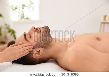 poster of Handsome Man Receiving Face Massage In Spa Salon
