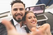 Beautiful Happy Couple Taking Selfie On Yacht Deck Floating In Sea. Sailing, Technology, Tourism, Tr poster