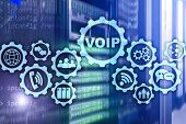 Voip Voice Over Ip On The Screen With A Blur Background Of The Server Room. The Concept Of Voice Ove poster