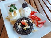 Chocolate Lava Cake With Icecream And Fresh Fruit On White Plate. poster