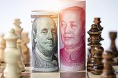 Us Dollar And Yuan Banknote With Chess For Tariff Trade War Between United States And China Which Bo poster