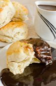 stock photo of biscuits gravy  - Scones with chocolate gravy - JPG