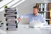 Businessperson Pushing Paper Documents Away And Working With Digital Documents On Computer Instead poster
