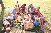 High Angle Top View Of Happy Families Having Fun With Kids At Pic Nic Barbecue Party - Multiracial L poster