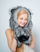Fur Fashion. Small Fashionista. Small Girl Wear Winter Hat Scarf. Happy Child Smile In Fashion Style poster