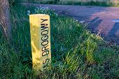 A Yellow Road Post Standing By The Road. Marking Of The Road Lane On The Side Of The Road. Season Of poster