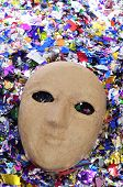 a simple paper-mache mask with confetti of different colors
