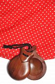 stock photo of castanets  - closeup of castanets and flamenco dress typical of Spain - JPG