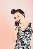 Music, Look And Retro Style, Pinup. Girl In Glasses Sing In Microphone. Pin Up Young Girl On Pink Ba poster