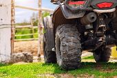 Atv Quad Bike Vehicle Standing Near Wooden Fence At Farm Or Horse Stable. Back View Of All Wheel Dri poster
