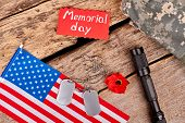 Veterans Accessories On Wood. American Flag, Dog Tags, Red Poppy And Torch. Attributes For Memorial  poster