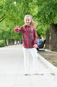 Childhood Activities That Will Never Grow Old. Happy Little Child Wearing Casual Plaid Design For Pl poster