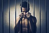 picture of delinquency  - Young man in prison - JPG