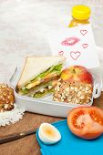 Love note with lipstick kisses in a lunchbox