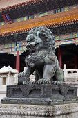 picture of plinth  - Chinese stone lion on raised plinth outside temple - JPG