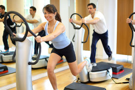foto of vibration plate  - Group of two men and one woman on a vibration massage plate in a gym - JPG