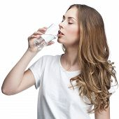 young beautiful brunette woman drinking water