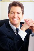 picture of male face  - Smiling handsome business man in the office - JPG