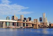 Brooklyn Bridge with lower Manhattan skyline panorama in the morning with  cloud and blue sky over E