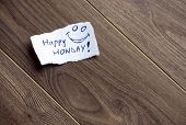 image of wood pieces  - Happy Monday written on piece of paper on a wood background - JPG