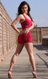 picture of tight dress  - Brunette in short red dress posing and showing off great legs - JPG
