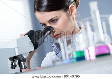 Female Researcher Using Microscope poster