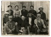 KURSK, USSR - CIRCA 1920s: An antique photo shows portrait of a group of peasants, members of the co