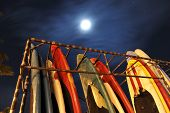 Rack Of Surfboards With Moon In Sky
