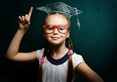 picture of pupils  - Genius girl in red glasses near blackboard in master hat - JPG